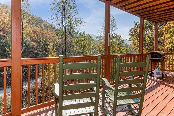 Rocking chairs looking at the view at Rocky Top Lodge, a 3 bedroom cabin rental located in Pigeon Forge