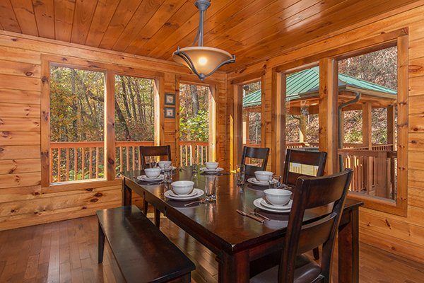 Dining table for six at Rocky Top Lodge, a 3 bedroom cabin rental located in Pigeon Forge