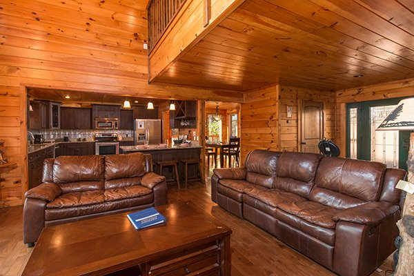 Main floor with living, dining, and kitchen space at Rocky Top Lodge, a 3 bedroom cabin rental located in Pigeon Forge