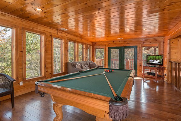 Pool table at Rocky Top Lodge, a 3 bedroom cabin rental located in Pigeon Forge