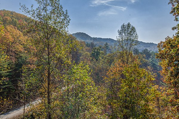 Mountain and fall colors viewed at Rocky Top Lodge, a 3 bedroom cabin rental located in Pigeon Forge
