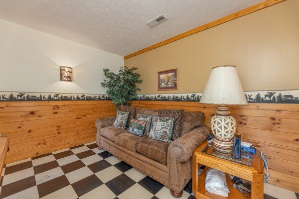 Sofa in the game room at Cub's Crossing, a 3 bedroom cabin rental located in Gatlinburg