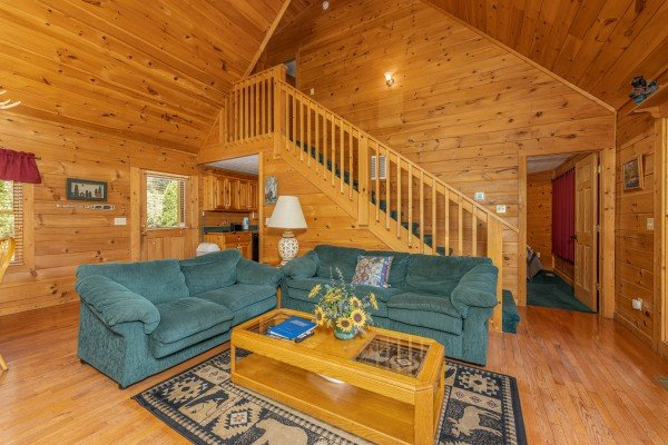 Sofa, loveseat, and coffee table at Cub's Crossing, a 3 bedroom cabin rental located in Gatlinburg