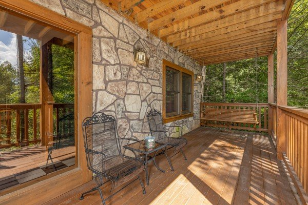 Lower deck seating and swing at Cub's Crossing, a 3 bedroom cabin rental located in Gatlinburg
