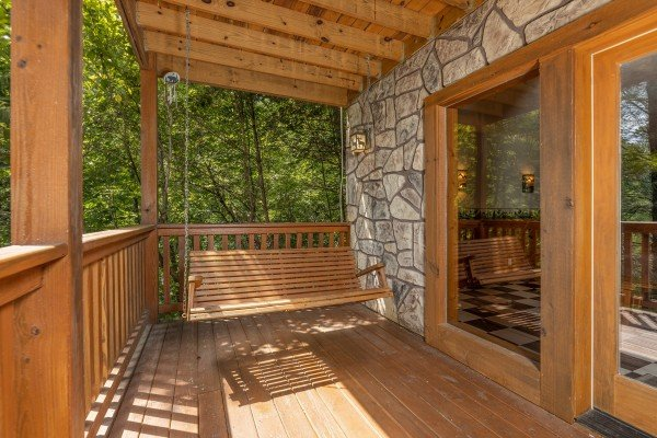 Porch swing at Cub's Crossing, a 3 bedroom cabin rental located in Gatlinburg