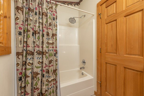 Bathroom with a tub and shower at Cub's Crossing, a 3 bedroom cabin rental located in Gatlinburg