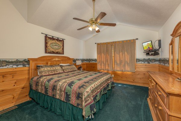 Bedroom with a queen bed, TV, and dresser at Cub's Crossing, a 3 bedroom cabin rental located in Gatlinburg