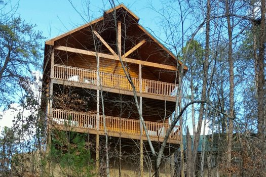 Looking up at two levels of deck at Endless Memories, a 2-bedroom cabin rental located in Pigeon Forge