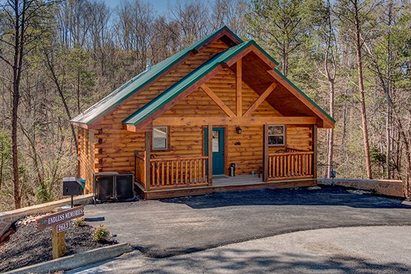 Front exterior and flat, paved parking at Endless Memories, a 2-bedroom cabin rental located in Pigeon Forge