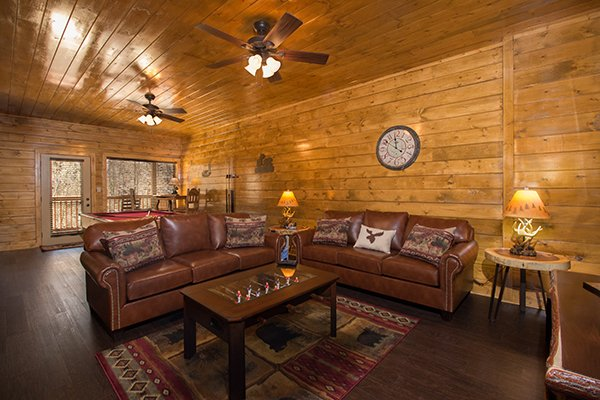 Living room with two leather sofas at Endless Memories, a 2-bedroom cabin rental located in Pigeon Forge