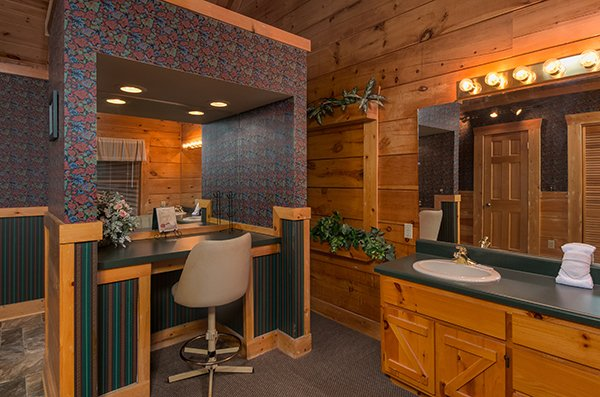 Vanity and bathroom sink off the bedroom at Little Moon, a 1 bedroom cabin rental located in Pigeon Forge