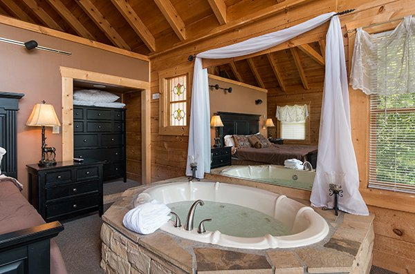 Jacuzzi tub in the bedroom at Little Moon, a 1 bedroom cabin rental located in Pigeon Forge