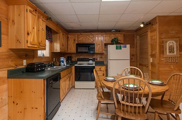 Kitchen with a dining set for four at Little Moon, a 1 bedroom cabin rental located in Pigeon Forge