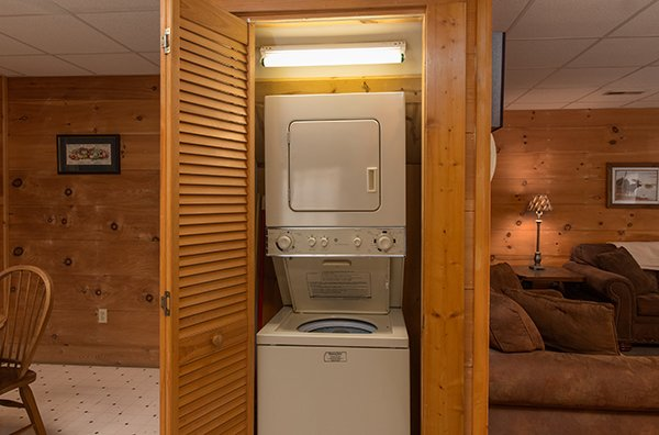 Stacked washer and dryer in a closet on the main floor at Little Moon, a 1 bedroom cabin rental located in Pigeon Forge