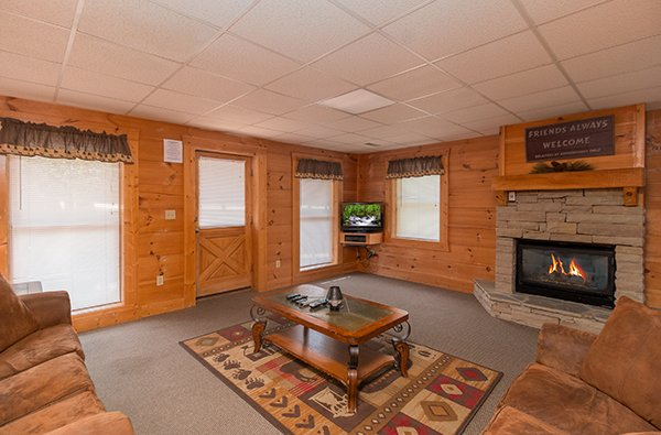 Television and fireplace in the living room at Little Moon, a 1 bedroom cabin rental located in Pigeon Forge