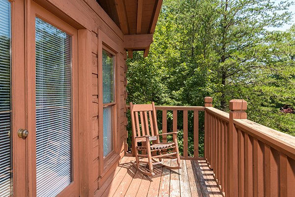 Rocking chair on the deck at Little Moon, a 1 bedroom cabin rental located in Pigeon Forge
