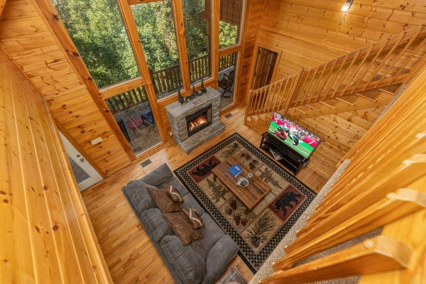 Looking down at the living room at Bear O'clock Somewhere, a 5 bedroom cabin rental located in Pigeon Forge