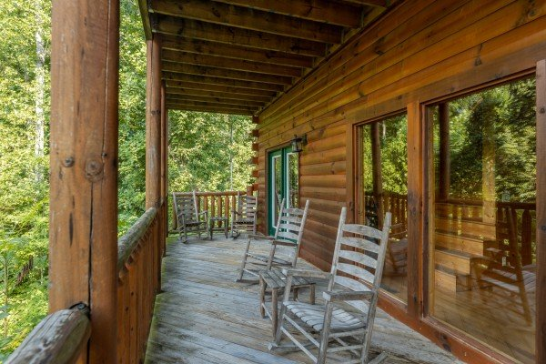 Deck with rocking chairs at Bear O'clock Somewhere, a 5 bedroom cabin rental located in Pigeon Forge