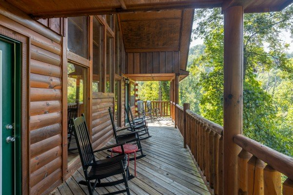 Rocking chairs on a deck at Bear O'clock Somewhere, a 5 bedroom cabin rental located in Pigeon Forge