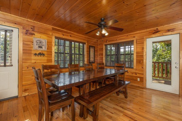 Dining table for 10 at Bear O'clock Somewhere, a 5 bedroom cabin rental located in Pigeon Forge