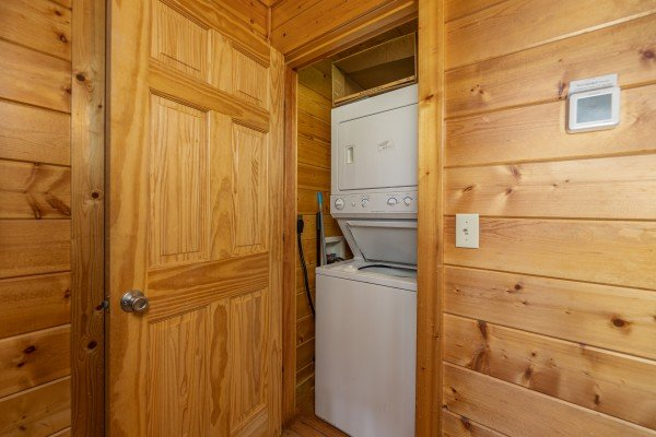 Stacked washer and dryer at Bear O'clock Somewhere, a 5 bedroom cabin rental located in Pigeon Forge