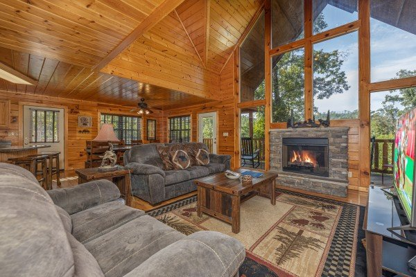 Living room seating at Bear O'clock Somewhere, a 5 bedroom cabin rental located in Pigeon Forge