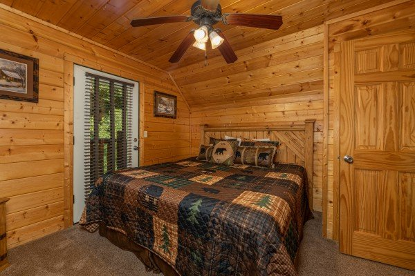 Bedroom with deck access at Bear O'clock Somewhere, a 5 bedroom cabin rental located in Pigeon Forge