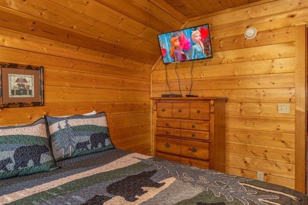 Dresser and TV in a bedroom at Bear O'clock Somewhere, a 5 bedroom cabin rental located in Pigeon Forge