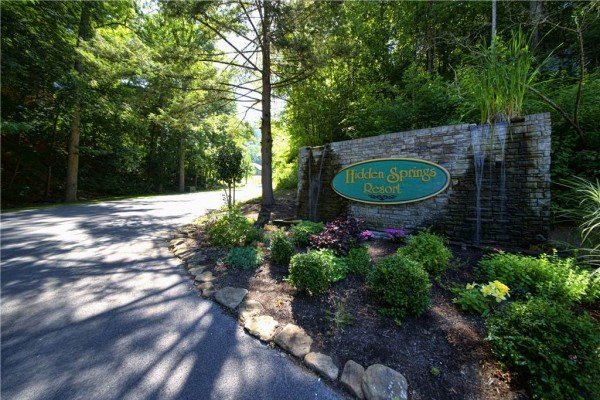 Hidden Springs Resort entrance to Bear O'clock Somewhere, a 5 bedroom cabin rental located in Pigeon Forge