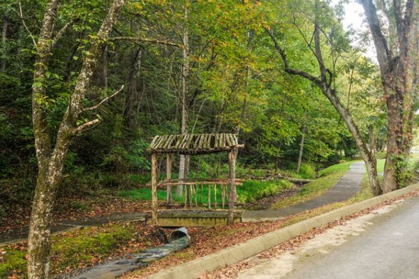 Nature trail for guests at Logged Inn, a 3 bedroom cabin rental located in Pigeon Forge