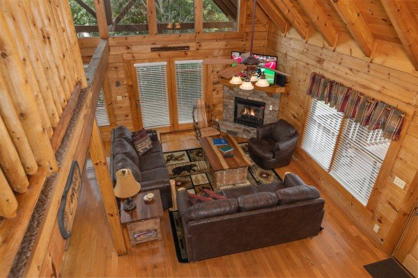 Looking down at the living room at Logged Inn, a 3 bedroom cabin rental located in Pigeon Forge