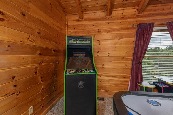 Arcade game at Logged Inn, a 3 bedroom cabin rental located in Pigeon Forge