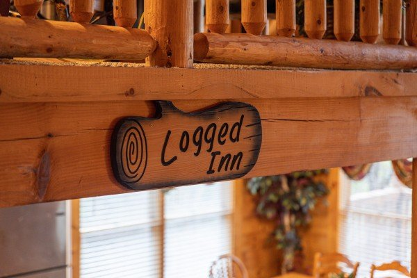 Log art at Logged Inn, a 3 bedroom cabin rental located in Pigeon Forge