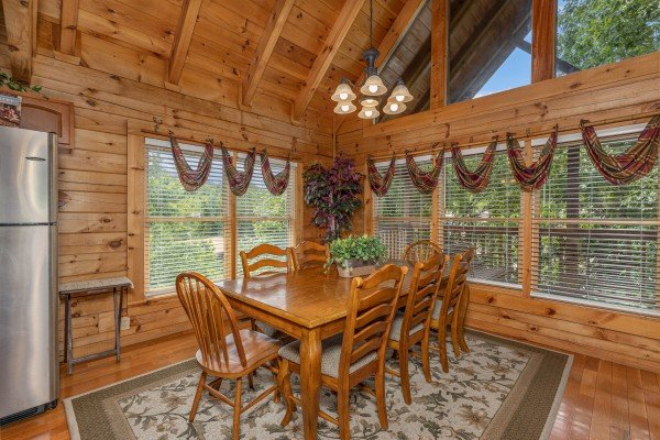 Dining table for 8 at Logged Inn, a 3 bedroom cabin rental located in Pigeon Forge