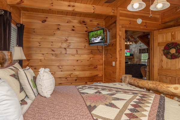 TV in a bedroom at Logged Inn, a 3 bedroom cabin rental located in Pigeon Forge
