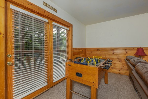 Foosball table at Logged Inn, a 3 bedroom cabin rental located in Pigeon Forge