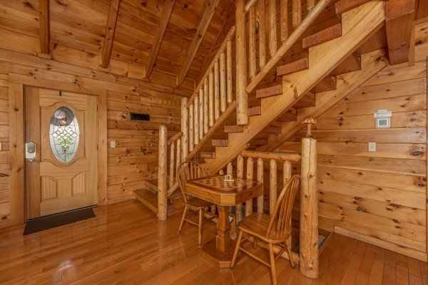 Foyer with table for two at Logged Inn, a 3 bedroom cabin rental located in Pigeon Forge
