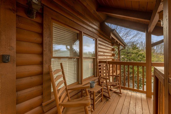 Front porch at Logged Inn, a 3 bedroom cabin rental located in Pigeon Forge