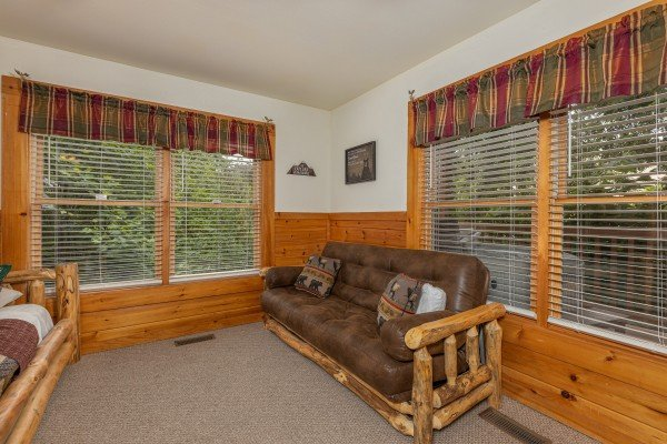 Futon at Logged Inn, a 3 bedroom cabin rental located in Pigeon Forge