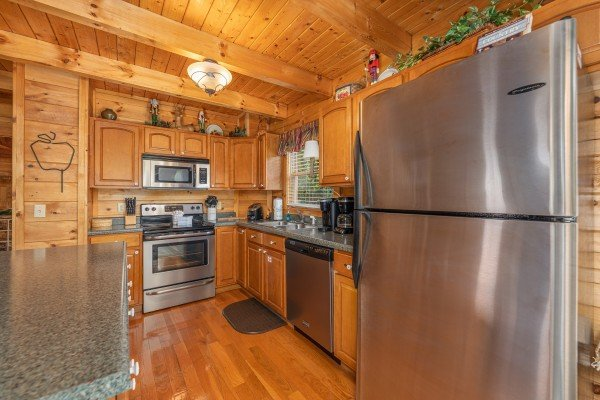 Kitchen with stainless appliances at Logged Inn, a 3 bedroom cabin rental located in Pigeon Forge