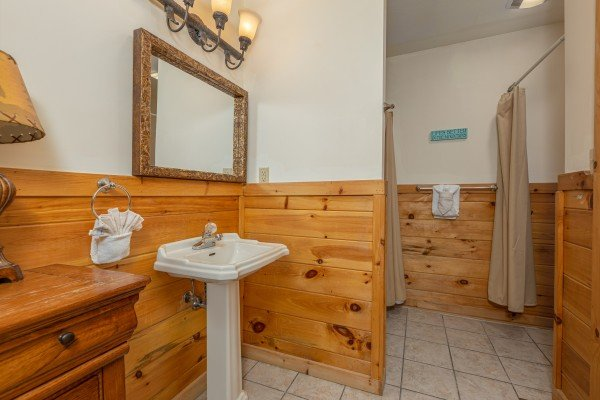 Bathroom with a pedestal sink at Logged Inn, a 3 bedroom cabin rental located in Pigeon Forge