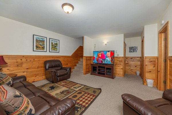 Living room with TV at Logged Inn, a 3 bedroom cabin rental located in Pigeon Forge