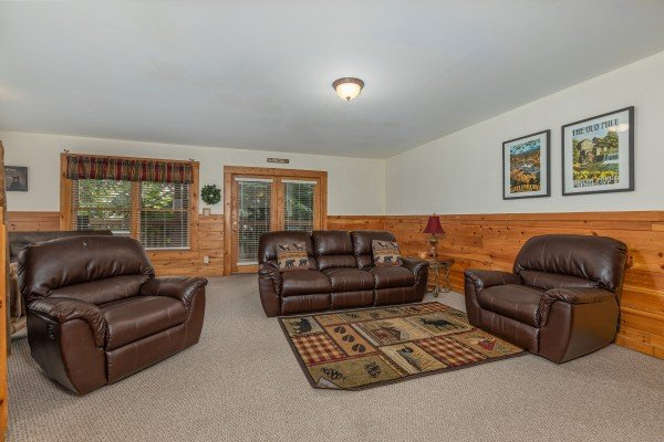 Sofa and two oversized chairs in a living room at Logged Inn, a 3 bedroom cabin rental located in Pigeon Forge