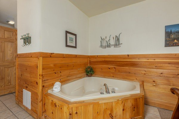 Corner jacuzzi tub at Logged Inn, a 3 bedroom cabin rental located in Pigeon Forge