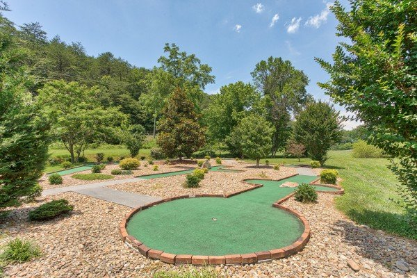 You'll have access to the resort's mini golf course at Happy Daze, a 2-bedroom Pigeon Forge cabin rental