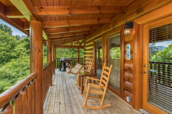 Rocking chairs on the covered deck at Happy Daze, a 2-bedroom Pigeon Forge cabin rental