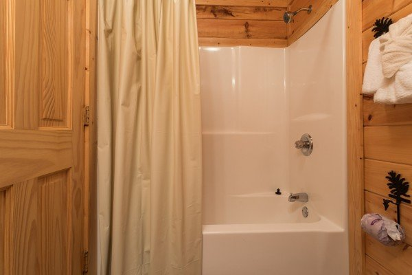 Bathroom with a tub and shower at Happy Daze, a 2-bedroom Pigeon Forge cabin rental