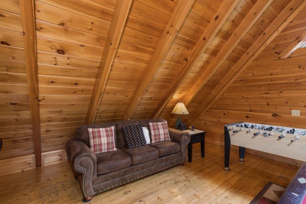 Sleeper sofa in the game loft at Happy Daze, a 2-bedroom Pigeon Forge cabin rental