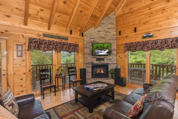 Living room with fireplace and TV at Happy Daze, a 2-bedroom Pigeon Forge cabin rental