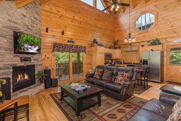 Living room, dining space, and kitchen at Happy Daze, a 2-bedroom Pigeon Forge cabin rental